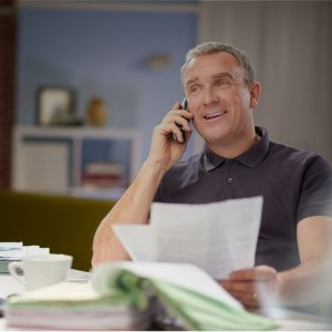 A man in his office provided by palago on the phone making deals